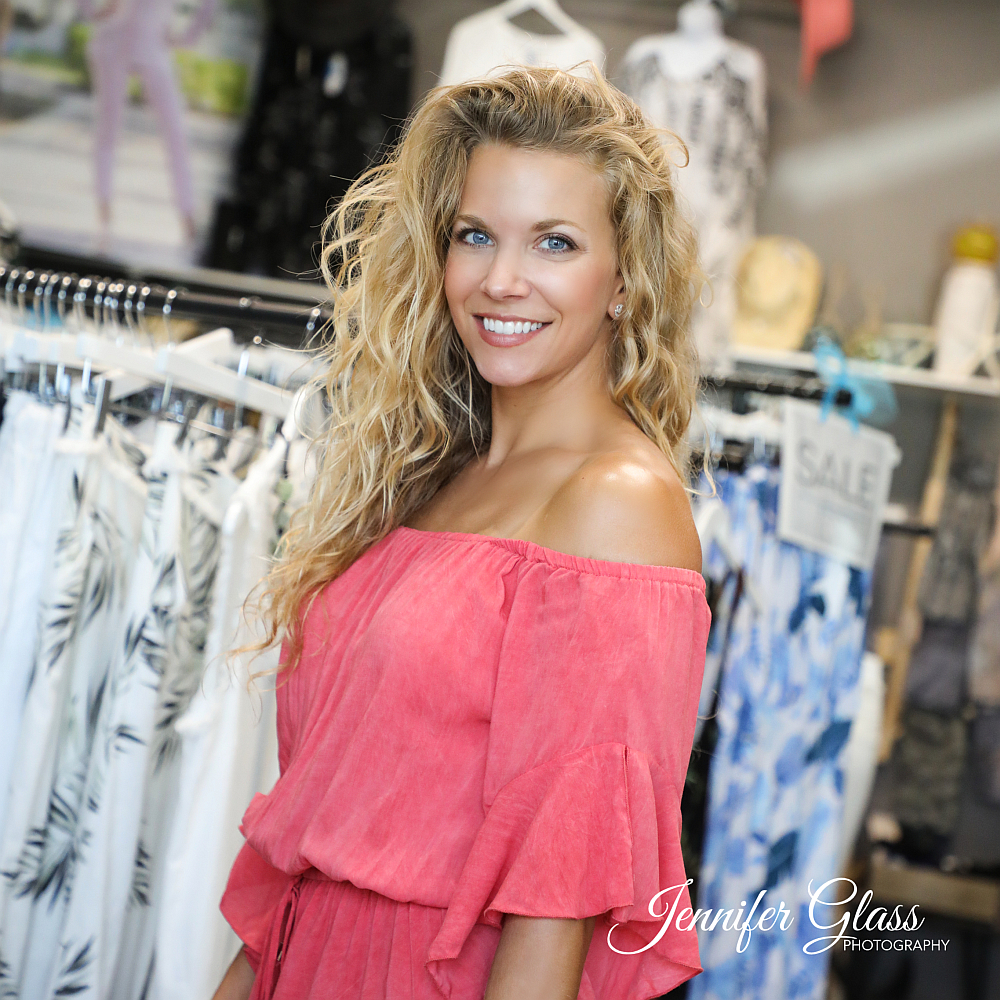 Beautiful blonde woman in clothing boutique
